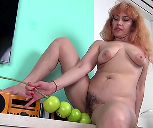 Redhead Mom Plays With Apples