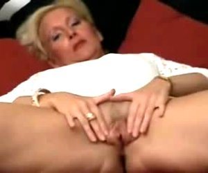 Hot lady fingering her gaping snatch