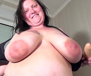 Big breasted mature BBW playing with her toy