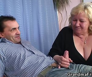 Busty granma in stockings takes two cocks
