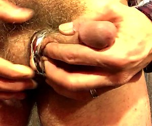 JamesRainmaker putting on a steel cockring