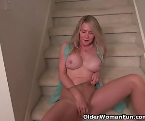 American milf Eva Griffin thumbs her nyloned moist coochie