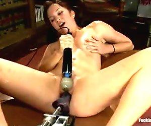 Small tittied asian fucks machine and vibrates pussy