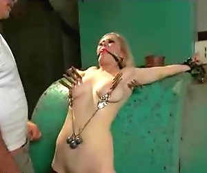 Zippered and weighted tits blonde fucked in basement