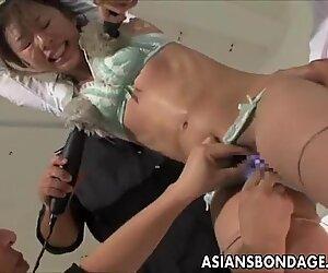 Cute Asian babe in electro play bondage scene