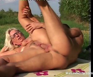 light-haired granny gets some jism on her glasses