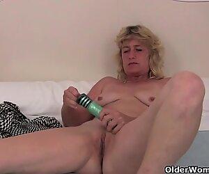 Grandma in heat fucks herself with a dildo