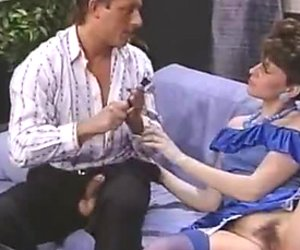 Sensual brunette in purple stockings seduces one horny dude