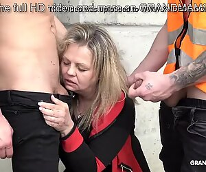 This old slut is so horny she sucks 2 construction workers at once