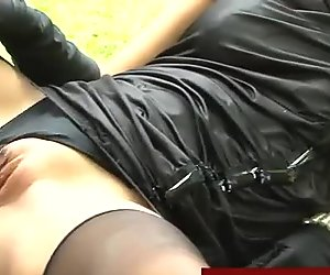 Outdoors threesome with clothed participants