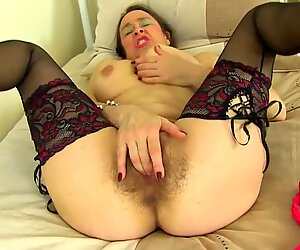 Mother fucks her old hairy pussy
