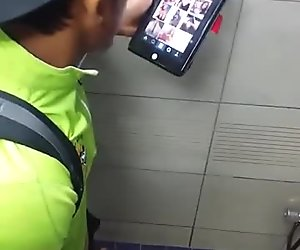 straight asian boy looking at mobile porn