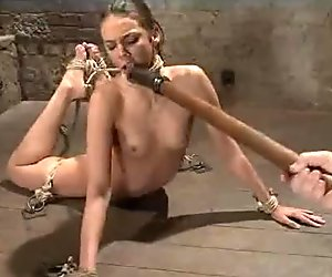 Tied to the floor babe gets vibed and toyed