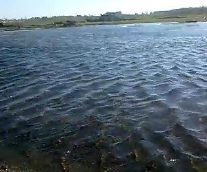 Pissing outdoor in water