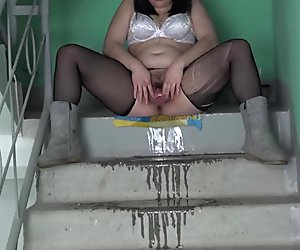 girl with hairy pussy, urinating in the stairwell