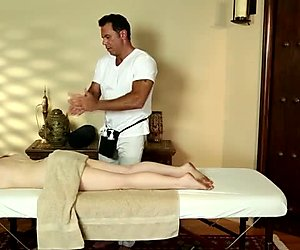 Horn-mad masseur gets naughty and rubs clit of long haired redhead