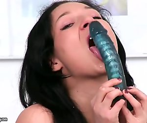 Freaky street tramp Anne Angel shoves in a big dildo in her asshole
