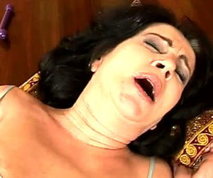 Skanky brunette granny enjoys intensive dildo fuck from grey haired man